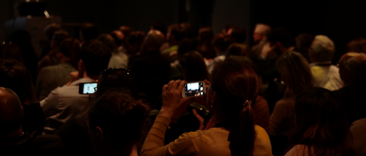 Attendees taking pictures of the congress